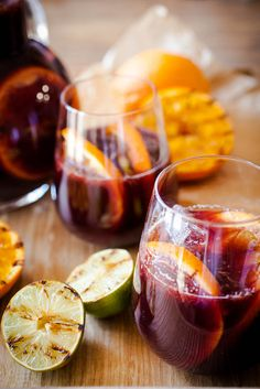 Juicy summer sangria with grilled oranges and lime. Guaranteed crowd pleaser.