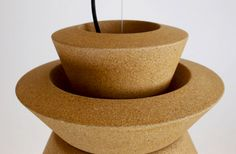The designers of CASCA are always looking for new materials and using them appropriately in a new context. Fascinated by the structure and the qualities of cork, they created a new lamp collection using cork as the main material. The individual parts of the three- part lampshade are out of cork and treated with natural oil as well as varnished with colours on natural-oil-basis.