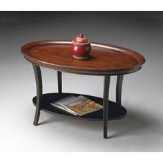 Butler Specialty 1591104 Oval Cocktail Coffee Table by Butler Specialty Company. $519.00. 38 in. W x 24 in. D x 22 in. H. Lower shelf for display purposes. Hand painted finish on selected hardwoods, choice cherry veneers, and wood products. Caf Noir finish. Finish:Caf Noir  Oval Cocktail Table  Unique hand painted design on solid woods and wood products.  Lower shelf for display purposes.