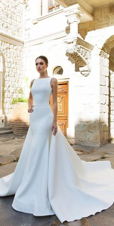 vey modern sleeveless waist band wedding dress, long train and ivory color, fit for a timeless bride