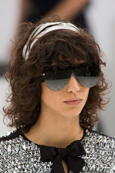 Headbands are making the runway rounds, going gilded or sporty with some pirate vibes for good measure. Pictured: Chanel   - HarpersBAZAAR.com