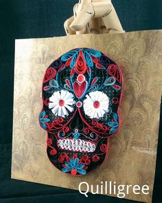 Check out this item in my Etsy shop https://www.etsy.com/uk/listing/268823832/quilled-sugar-skull-calavera