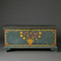 Paint-decorated Pine Blanket Chest, Schoharie or Albany County, New York, 1815-30, the molded lift top opens to a well with till, all on a molded bracket base, with original painted decoration of