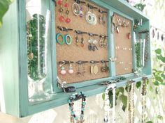 jewelry organizer. This could easily be made with an old drawer, glue in some cork board, and add some special hooks or even drawer knobs to hold the necklaces.  Awesome idea!