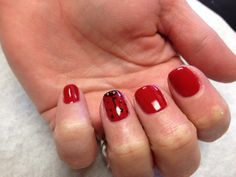 Red with lady bug design on the accent nails  Oasis Salon and Spa Mill Hall Pa (570)726-6565
