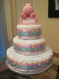 Adorable Little Hands and Feet diaper cake! This precious, pastel diaper cake is perfect for celebrating a new baby.