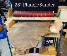 "In this instructable we will cover the steps and materials necessary to build the 28"" Sander-Planer. Background: While driving across the USA on a vacation we happened across a small warehouse in California that sells rough cut redwood burl slabs. I really liked the piece in the second photo but it had a problem - it had been rough cut using a chain saw and the two faces were not parallel. At 26"" wide and close to 36"" long it was too big for my 12 1/2"" planer, and a hand p..."