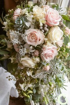 Cascading wedding bouquet of roses, orchids, brunia, spray roses and succulents - pink and grey wedding - Laurel Weddings