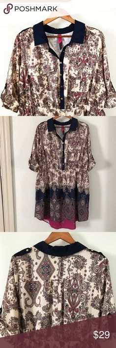 PLUS Pure Energy Paisley Shirt Dress Simply lovely Paisley print shirt dress. Colors are cream, navy blue, and purple. Tabbed short sleeves (elbow length) and shoulders, navy collar with gold buttons down the front, elastic waistline. Two Pocket front. 100% polyester. Pure Energy Dresses Mini