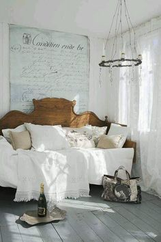 Take an old bed frame shorten it to become a day bed - kind like making a bench out of a bed frame.