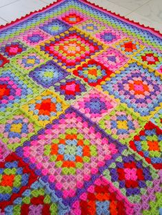 Rainbow Granny...a little bright for me, but I like the use of different sizes of squares.