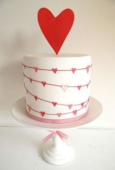 Brides.com: . Heartstrings with Giant Topper Wedding Cake. This one-layer wedding cake baked by Just Call Me Martha has double the love with an adorable string of hearts and an outsized heart topper.  Browse unique wedding cake ideas.