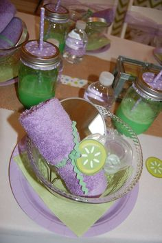 Purple and green place settings at a spa party! See more party planning ideas at CatchMyParty.com!