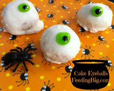 Cake Eyeballs with Feeding Big.  Red Velvet Cake covered with white chocolate!  Yum  Treat your little trickers with this yummy dessert! #cake #halloween #treats
