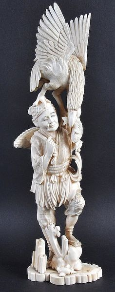 Description: A LATE 19TH CENTURY JAPANESE MEIJI PERIOD IVORY OKIMONO depicting a fisherman holding aloft a well carved eagle. Small loss to base. 14.5ins high