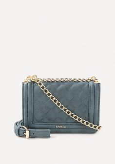 Posh little crossbody bag in a chic quilted design finished with gleaming  chain strap. Interior