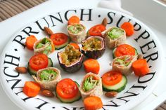 Wraps filled with smoked salmon, creamcheese and vegetables. Carrots, cucumber, almonds and passionfruit on the side.