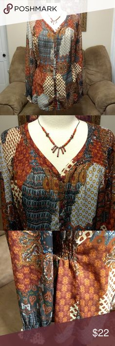 Denim 24/7 Blouse Top Button Down 18W Paisley Brand:  Denim 24/7 Size:  18W Description:  Beautiful, flowy blouse.  Smocked across the top, front and back.  The end of each sleeve. And at the waist starting at each side and across the back to allow for stretch.  Light fabric.  Button down the front with an extra button sewn into the inside. Fabric: 100% Polyester Condition:  Great, gently used condition.  No noticeable tears, smells or stains.  Please check all of the pictures and ask any…
