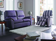 Trinity and Metro represent a more contemporary upholstery look, shown here in Dock Fabric and with contrasting 'Vista' stripe on the recliner. Although modern these furniture ranges still benefit from our traditional hand build techniques, made in the same way since the 1930's