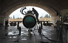 MiG-21 aircraft of the Syrian Air Force gets ready for a mission at the ...