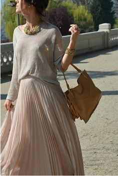 sneakers and pearls,neutral tones, street style, soft pink pleated skirt, trending now.jpg