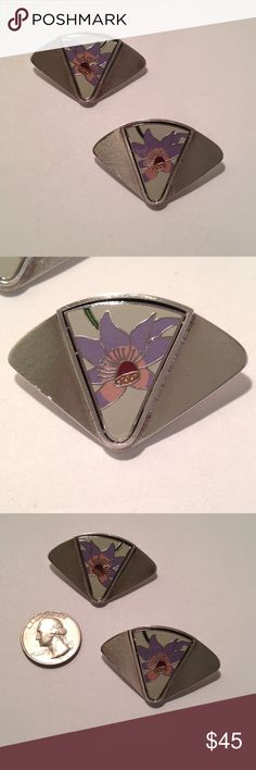 """Sterling Laurel Burch clip on earrings Sterling and enamel clip on Laurel Burch earrings. Enamel flower design in the colors of white, violet, pink, maroon, orange and black. Marked Laurel Burch, measures 1 1/4"""" long 1 7/8"""" wide. Not marked Sterling but tested positive Laurel Burch  Jewelry Earrings"""