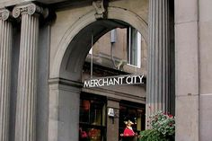 Merchant City, Glasgow. Signage system of 10m high stainless steel signs and a trail of bronze plaques to identify the Merchant City as Glasgow's cultural quarter. Designed by Graven Images.  www.graven.co.uk