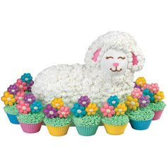 Lounging Lamb Cake - A sweet field of cupcakes topped with flower-shaped candy surrounds this adorable lamb cake. The Stand-Up Lamb Pan Set is the key to this spring celebration treat. Wilton Cake Decorating, Cake Decorating Tools, Cookie Decorating, Decorating Ideas, Easter Lamb, Easter Food, Easter Dinner, Easter Ideas, Easter Recipes