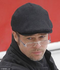 Specs appeal: Even with the silver fox stubble, Brad looks younger than his 46 years, even if his eyesight is showing signs of ageing..