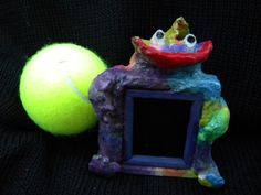 Truman Funny little monster, one of only six or seven similar frames in papier-mâché. This is definitely an absolute one-of-a-kind item www.amazon.com/shops/iheartcatsndogs
