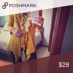 Gorgeous Mustard Cardigan Sweater with ruffles Mustard is the color of the season this year, and this cardigan sweater does not disappoint! Mid-weight feel. Can be worn tied in the front or un-done. This cozy fabric has some stretch to it. Perfect with jeans, a skirt or over your favorite dress. It's only been washed/worn twice, but the fabric did start some minor piling in a few spots. Like new aside from that. Sweaters Cardigans