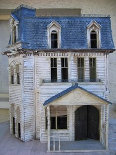 Beautiful vintage doll house... i had one that my grandfather made for me and my brothers locked my cat in it ..alas !!1