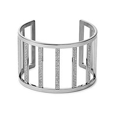 Balancing statement with simplicity, this striking cuff adds a touch of glamour without going over the top. A sleek cage design is set with a sprinkling of sparkling pavé stones for a look that's equal parts opulent and everyday. Pair this piece with office attire for extra daytime polish or team it with your favorite evening ensemble to add a little fuss-free shine.