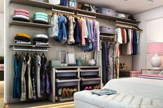 Finesse wardrobe closet inspired by Italian design features linen drawers, floated shelving and rods and plenty of counter space.
