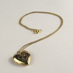 Vintage Heart Locket Necklace... So pretty and I love the old fashioned part about it :)