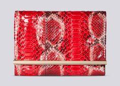 """""""Maysa Bag""""  Clutch de piel de pitón, en tonos rojos y anaranjados, de la colección Samba de Carolina Herrera"""