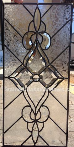 This classic Clear beveled glass window Stained Glass Window Panel is 12 wide x 28 high and can be custom made to any size or colors you need for your specific project. Did you know most stained glass panels on the Internet are made in China with a lower quality Chinese made