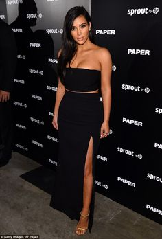 If you've got it: Kim Kardashian wore a slinky black ensemble as she posed at the release of Paper magazine's winter issue in Miami, Florida on Thursday