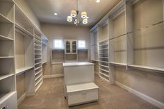 Traditional Closet with Carpet, California Closets Custom Wardrobe, Built-in bookshelf, Chandelier