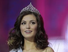 Yulia Skalkovich smiles during the awards ceremony after winning the Miss Belarus Beauty Contest 2012 in Minsk, May 4, 2012.