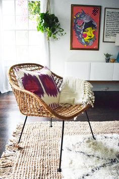 The layers of texture make this room. Two rugs, plants, pillows and throws.