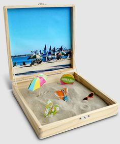 Photo sandbox - a desktop sandbox featuring a favorite vacation photo is just the thing to relive the vacation fun once you're back to work!  Print the photos at Kodak Picture Kiosk.