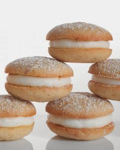 Banana Whoopie Pies | These golden-edged banana cookies stuffed with cream cheese frosting unite two favorites -- whoopie pie and moist banana cake -- in an immensely satisfying revival.