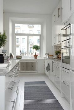 open galley kitchen Galley Kitchen Remodel Ideas - A galley kitchen is a household kitchen design which consists of two parallel runs of units. White Galley Kitchens, Galley Kitchen Design, Galley Kitchen Remodel, New Kitchen, Home Kitchens, Kitchen White, Kitchen Remodeling, Kitchen Ideas, Remodeling Ideas