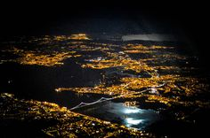 Portugal - Lisbon and a moon over the Tagus River. Photo by Luis Fernando Murillo.