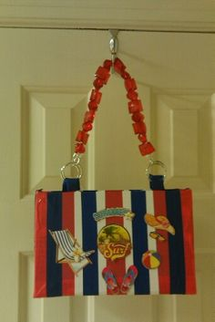 CELEBRATE SUMMER WITH ONE OF A KIND RED, WHITE, AND BLUE POCKETBOOK.