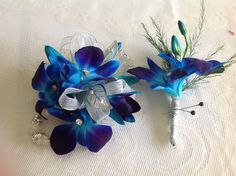 Matching blue orchid boutonnière and corsage #prom #floweramaatlanta