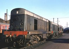 D8002 (later 20002) with two of her Class 20 sisters at Willesden in June 1962. Built at the English Electric Vulcan Foundry and delivered on 25th July 1957. Withdrawn on 19th Feb 1988 and cut up at MC Metals, Glasgow on 24th Sept 1990. (Grahame Wareham)