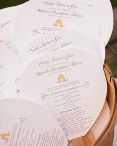 At this August barn wedding in Wisconsin, the order of events was corraled on these fans featuring a yellow barn motif at the top.