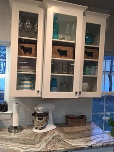 My home Wolf AMERICAN standard shaker cabinets in white glass fronts mini beveled subway tile in white Merola from Home Depot fantasy brown quartzite aka marble lol all put together with my teals and burlap cows so addicted to mason jars cups or storage Fantasy Brown Quartzite, Mason Jar Cups, Beveled Subway Tile, Kitchen Upgrades, Kitchen Ideas, Blue Backsplash, Shaker Cabinets, Put Together, American Standard